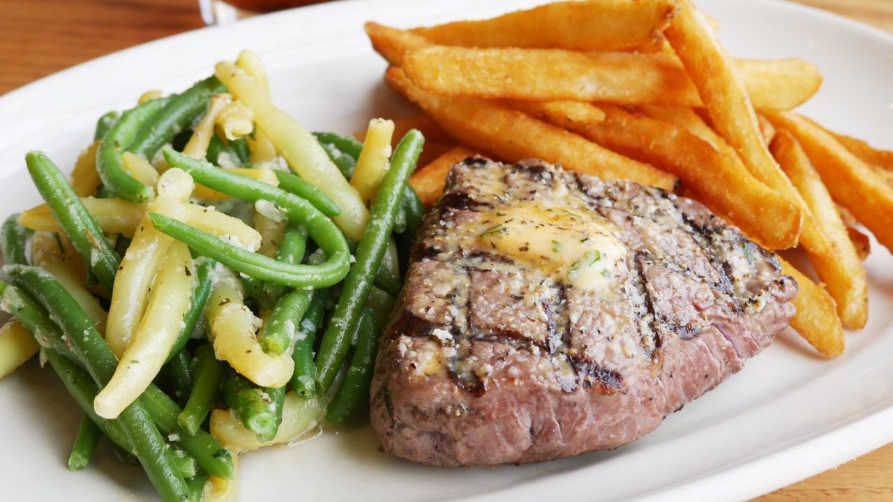 picture of sirloin steak with fried and vegetables